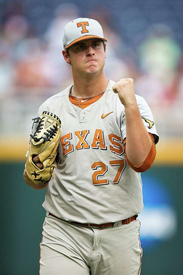 Texas pitcher Travis Duke celebrates the Longhorns' 4-1 victory over Louisville in game 5 during the College World Series at TD Ameritrade Park in Omaha, Neb., Monday, June 16, 2014.  (AP Photo/The Omaha World-Herald/Chris Machian) Photo: CHRIS MACHIAN, Associated Press / OMAHA WORLD-HERALD