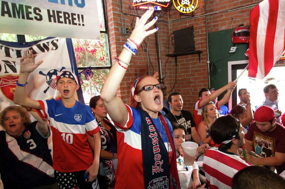 United States soccer fans cheer during the U.S. World Cup match against Ghana during a watch party at Lucky's Pub Monday, June 16, 2014, in Houston. Photo: Brett Coomer, Houston Chronicle / © 2014 Houston Chronicle