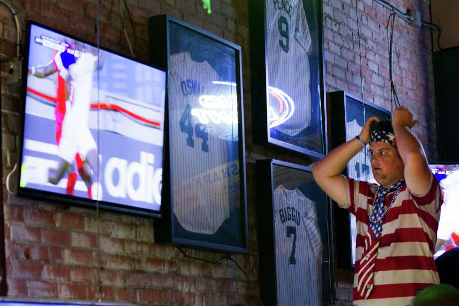 United States soccer fan reacts to the injury by U.S. player Jozy Altidore during the U.S. World Cup match against Ghana during a watch party at Lucky's Pub Monday, June 16, 2014, in Houston. Photo: Brett Coomer, Houston Chronicle / © 2014 Houston Chronicle