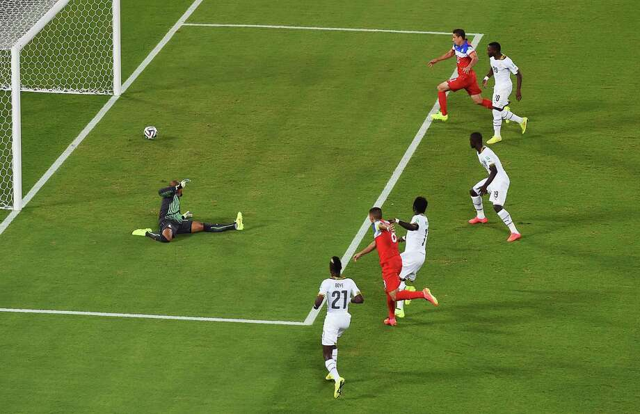 NATAL, BRAZIL - JUNE 16:  Clint Dempsey of the United States shoots and scores his team's first goal past goalkeeper Adam Kwarasey of Ghana during the 2014 FIFA World Cup Brazil Group G match between Ghana and the United States at Estadio das Dunas on June 16, 2014 in Natal, Brazil. Photo: Laurence Griffiths, Getty Images / 2014 Getty Images