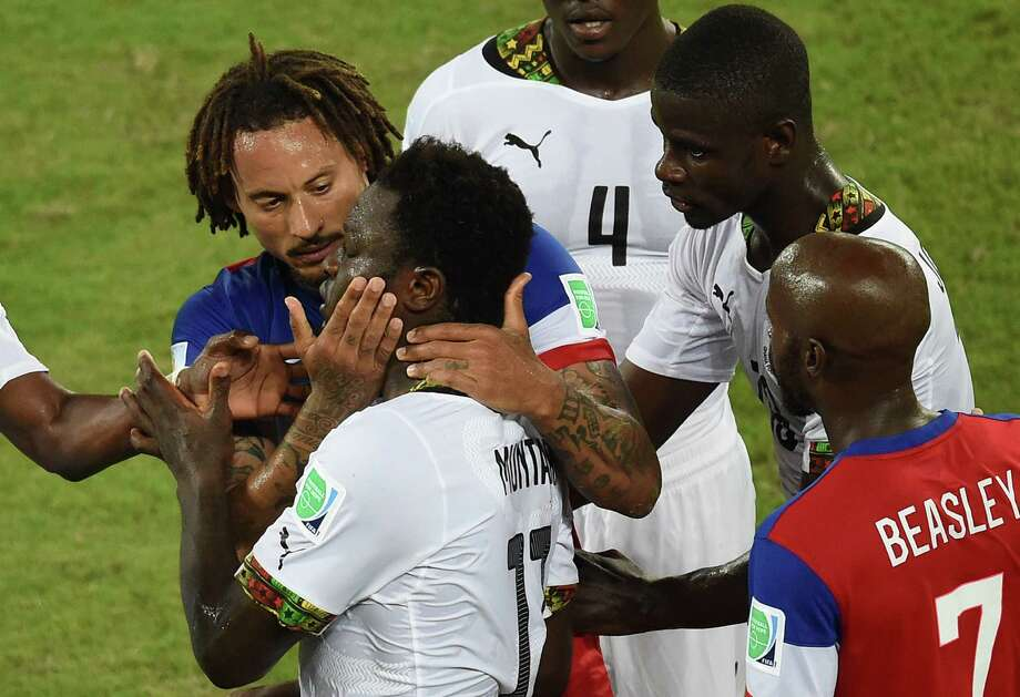Ghana's midfielder Sulley Ali Muntari (2L) and US midfielder Jermaine Jones (L) argue during a Group G football match between Ghana and US at the Dunas Arena in Natal during the 2014 FIFA World Cup on June 16, 2014.  AFP PHOTO / JAVIER SORIANO Photo: JAVIER SORIANO, AFP/Getty Images / AFP