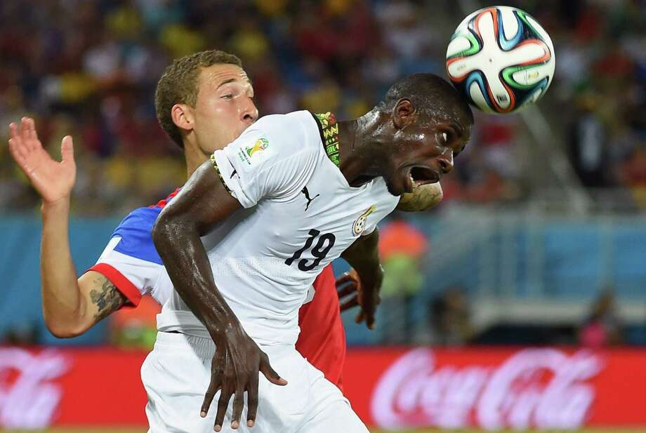 Ghana's defender Jonathan Mensah (R) heads the ball in front of US defender Fabian Johnson during a Group G football match between Ghana and US at the Dunas Arena in Natal during the 2014 FIFA World Cup on June 16, 2014.   AFP PHOTO / EMMANUEL DUNAND Photo: EMMANUEL DUNAND, AFP/Getty Images / AFP