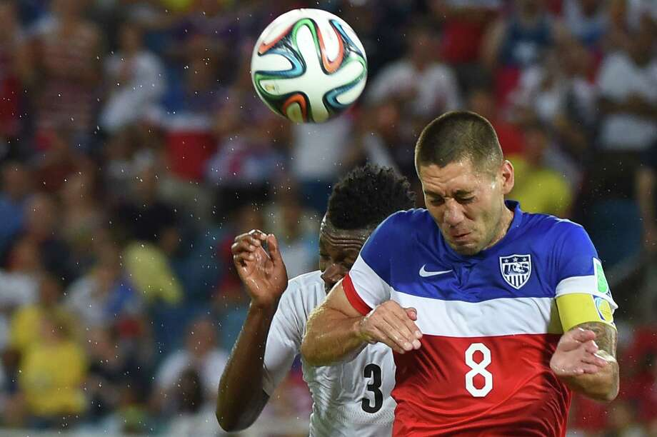 US forward Clint Dempsey (R) and Ghana's forward Asamoah Gyan (L) jump for the ball during a Group G football match between Ghana and US at the Dunas Arena in Natal during the 2014 FIFA World Cup on June 16, 2014.  AFP PHOTO / EMMANUEL DUNAND Photo: EMMANUEL DUNAND, AFP/Getty Images / AFP