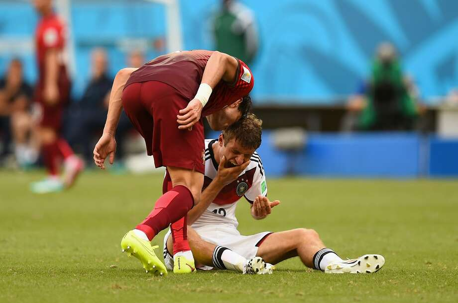 Portugal's Pepe (left) earns a red card by head-butting Thomas Mueller. Mueller scored three goals for Germany. Photo: Stu Forster, Getty Images