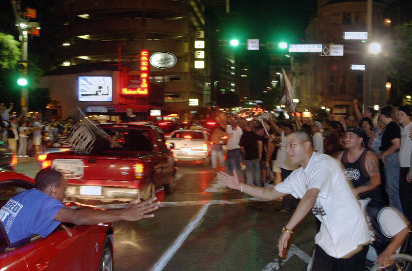 2. Drive down Commerce Street doing the 21-honk salute, Spurs car flags flying.