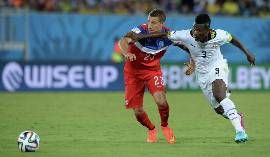 US defender Fabian Johnson (L) vies with Ghana's forward Asamoah Gyan (R) during a Group G football match between Ghana and US at the Dunas Arena in Natal during the 2014 FIFA World Cup on June 16, 2014.  AFP PHOTO / CARL DE SOUZA Photo: CARL DE SOUZA, AFP/Getty Images / AFP