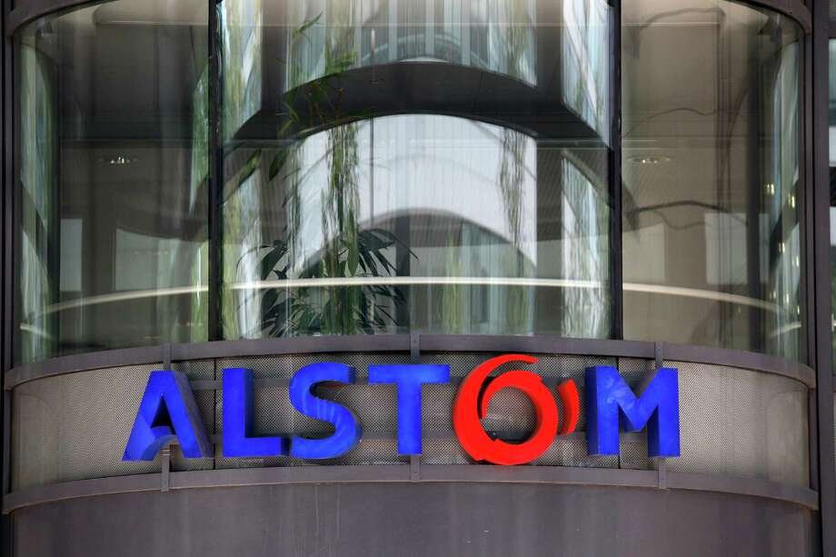 FILE - This Wednesday, April 30, 2014 file photo shows the company logo of Alstom at the headquarters of the leading global maker of high-speed trains, power plants and grids, in Levallois-Perret, outside Paris, France. Engineering giants Siemens of Germany and Mitsubishi Heavy Industries of Japan on Monday June 16, 2014 jointly offered to buy parts of France's Alstom and start a long-term partnership, a move that could derail a competing bid by General Electric. (AP Photo/Christophe Ena, File) ORG XMIT: LON120 Photo: Christophe Ena / AP
