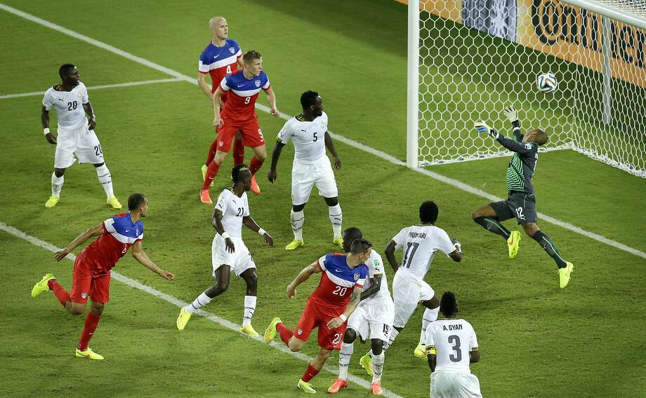 John Brooks (lower left) scores the second U.S. goal in the 86th minute of the team's Group G opener. Photo: Hassan Ammar, Associated Press