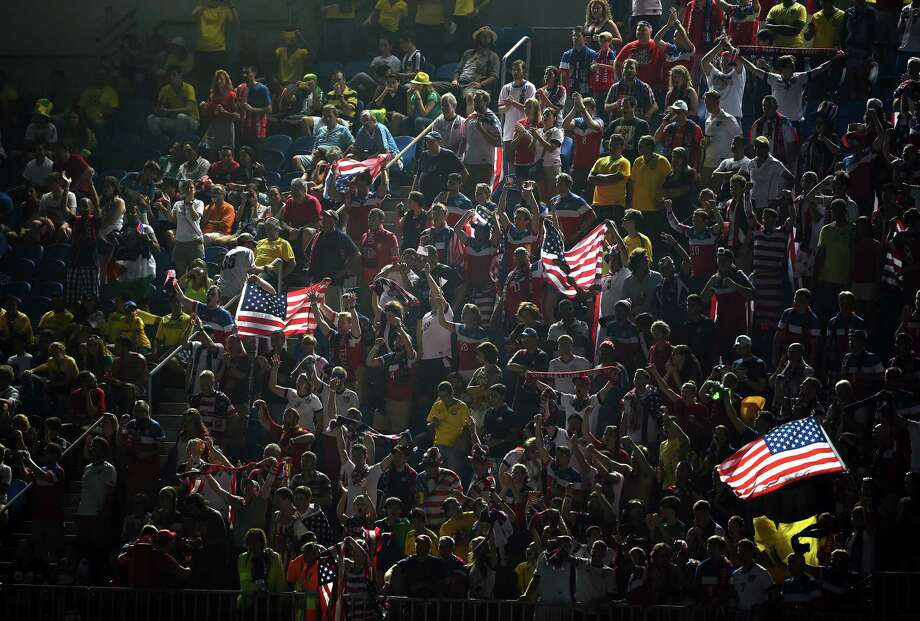 NATAL, BRAZIL - JUNE 16:  Fans of  the United States cheer during the 2014 FIFA World Cup Brazil Group G match between Ghana and the United States at Estadio das Dunas on June 16, 2014 in Natal, Brazil. Photo: Laurence Griffiths, Getty Images / 2014 Getty Images