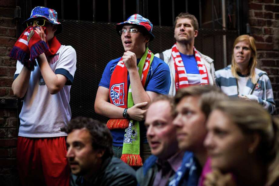 Fans react to the U.S. versus Ghana World Cup soccer match at a viewing party consisting of a TV set up in the back of a U-Haul truck Monday, June 16, 2014, in a Pioneer Square alley in Seattle, Wash. USA beat Ghana 2-1 in stoppage time. Photo: JORDAN STEAD, SEATTLEPI.COM / SEATTLEPI.COM
