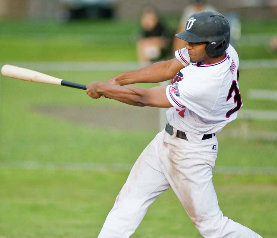 Danbury Westerners Joshua Palacios cuts at the ball during a game against the Mystic Schooners played at Rogers Park. Monday, June 16, 2014 Photo: Scott Mullin / The News-Times Freelance