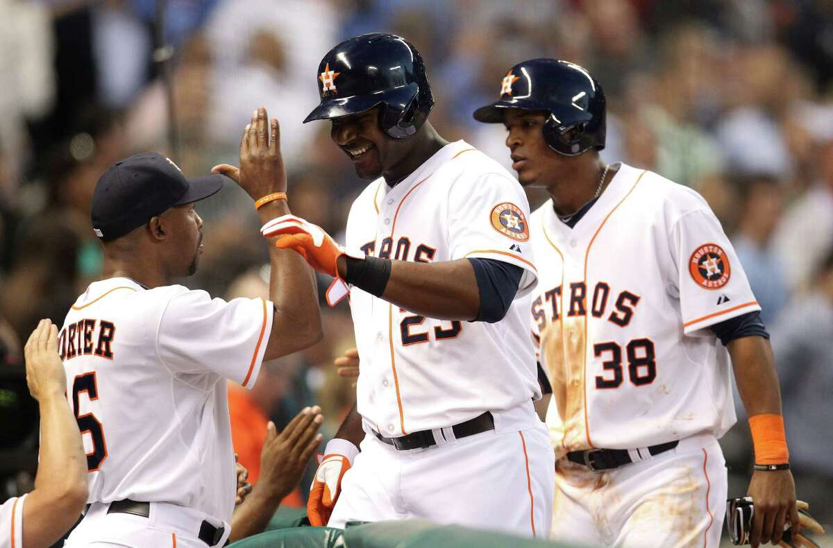 Chris Carter, right, responded positively after a recent benching by Bo Porter.
