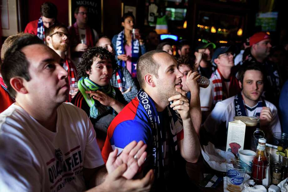 Fans react to the U.S. versus Ghana World Cup soccer match at a viewing party Monday, June 16, 2014, at Atlantic Crossing in Seattle, Wash. USA beat Ghana 2-1 in stoppage time. Photo: JORDAN STEAD, SEATTLEPI.COM / SEATTLEPI.COM
