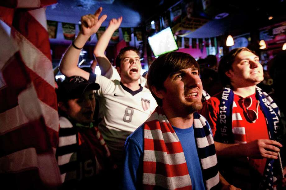 Fans react to the first goal by Clint Dempsey during the U.S. versus Ghana World Cup soccer match at a viewing party Monday, June 16, 2014, at Atlantic Crossing in Seattle, Wash. USA beat Ghana 2-1 in stoppage time. Photo: JORDAN STEAD, SEATTLEPI.COM / SEATTLEPI.COM
