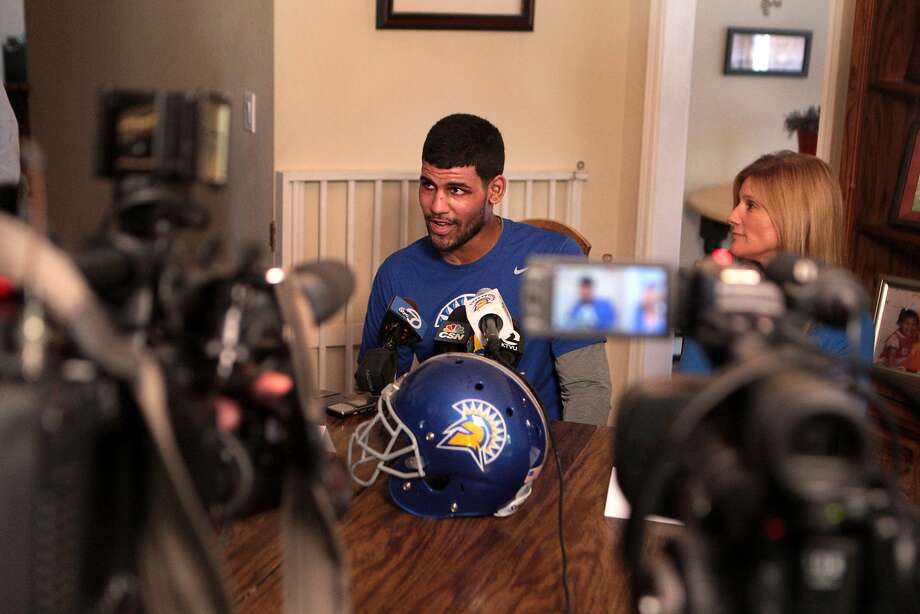 With mother Kirsten Hall at his side, San Jose State linebacker Jared Leaf talks to journalists at the family home in Martinez. Photo: Kevin N. Hume, The Chronicle