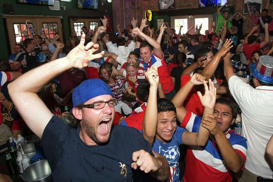 United States soccer fans celebrate the Americans' 2-1 World Cup win over Ghana  during a watch party at Lucky's Pub Monday, June 16, 2014, in Houston. Photo: Brett Coomer, Houston Chronicle / © 2014 Houston Chronicle