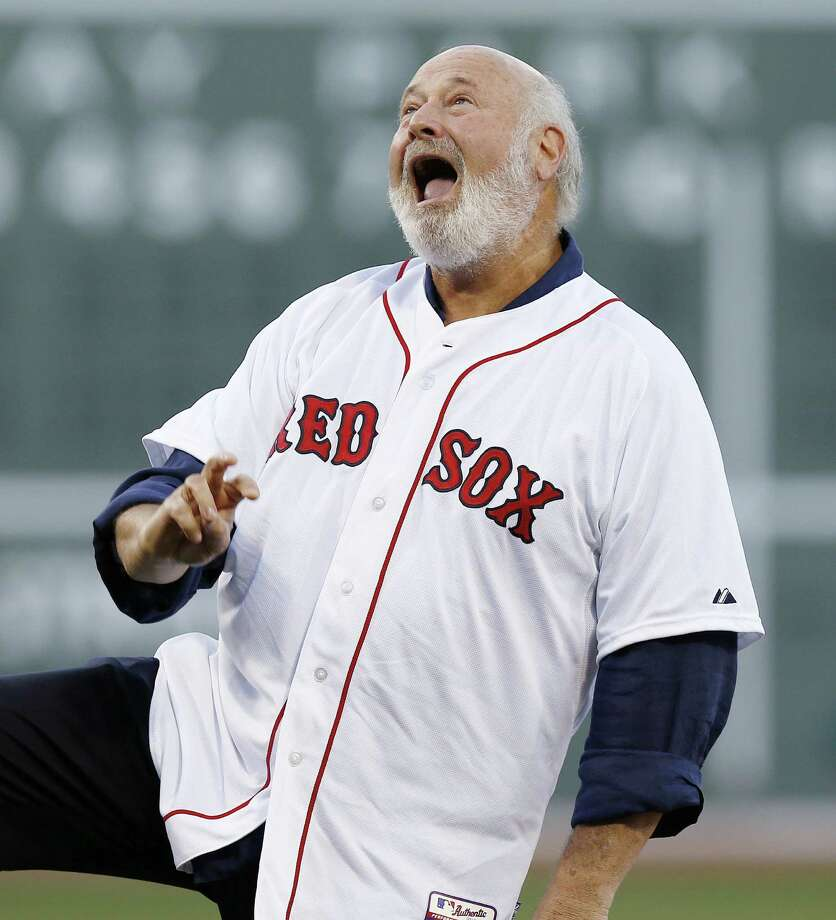 Rob Reiner reacts to his throw on the ceremonial first pitch in a baseball game between the Boston Red Sox and the Minnesota Twins in Boston, Monday, June 16, 2014. (AP Photo/Michael Dwyer) Photo: Michael Dwyer, Associated Press / AP
