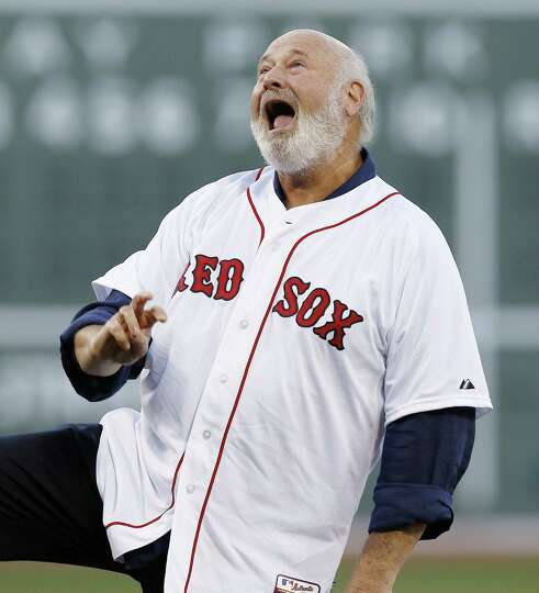 Rob Reiner reacts to his throw on the ceremonial first pitch in a baseball game between the Boston R