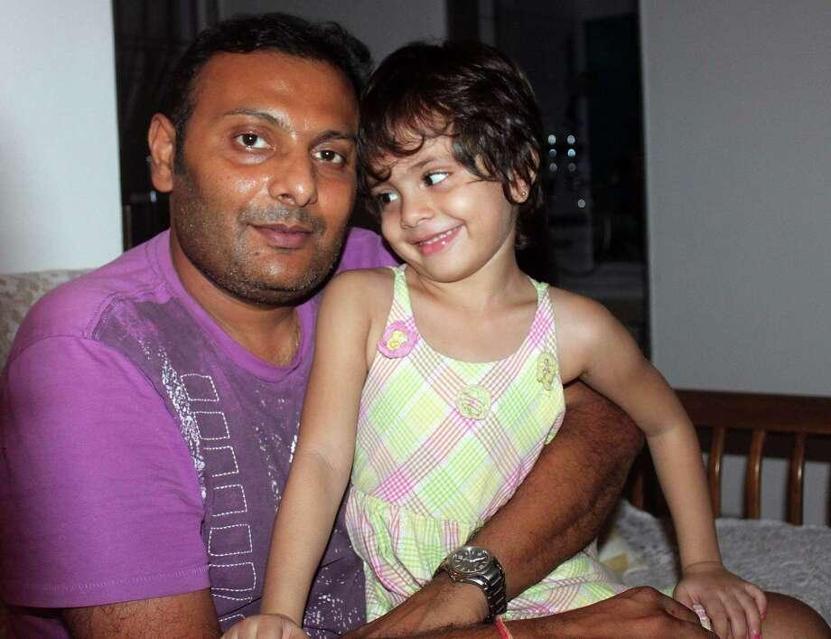 Medhavi Modi, right, was born through in vitro fertilization in India. But legally, she doesn't exist. Maulik Modi, her father, is an American citizen. Photo: Maulik Modi / family photo