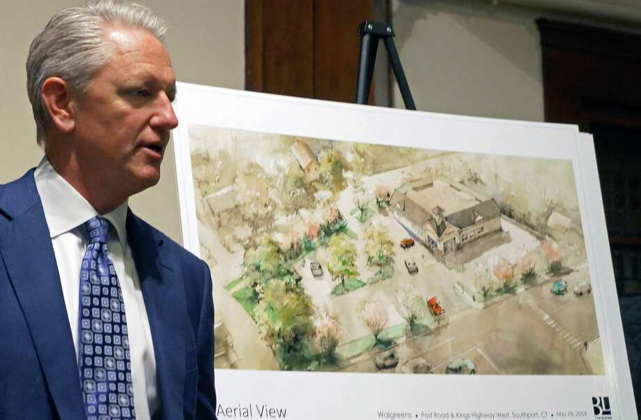 Attorney John Knuff faced a hostile crowd at a meeting with neighbors Monday about a proposed Walgreen's for property on the Post Road in the Southport section of town. Photo: Genevieve Reilly / Fairfield Citizen