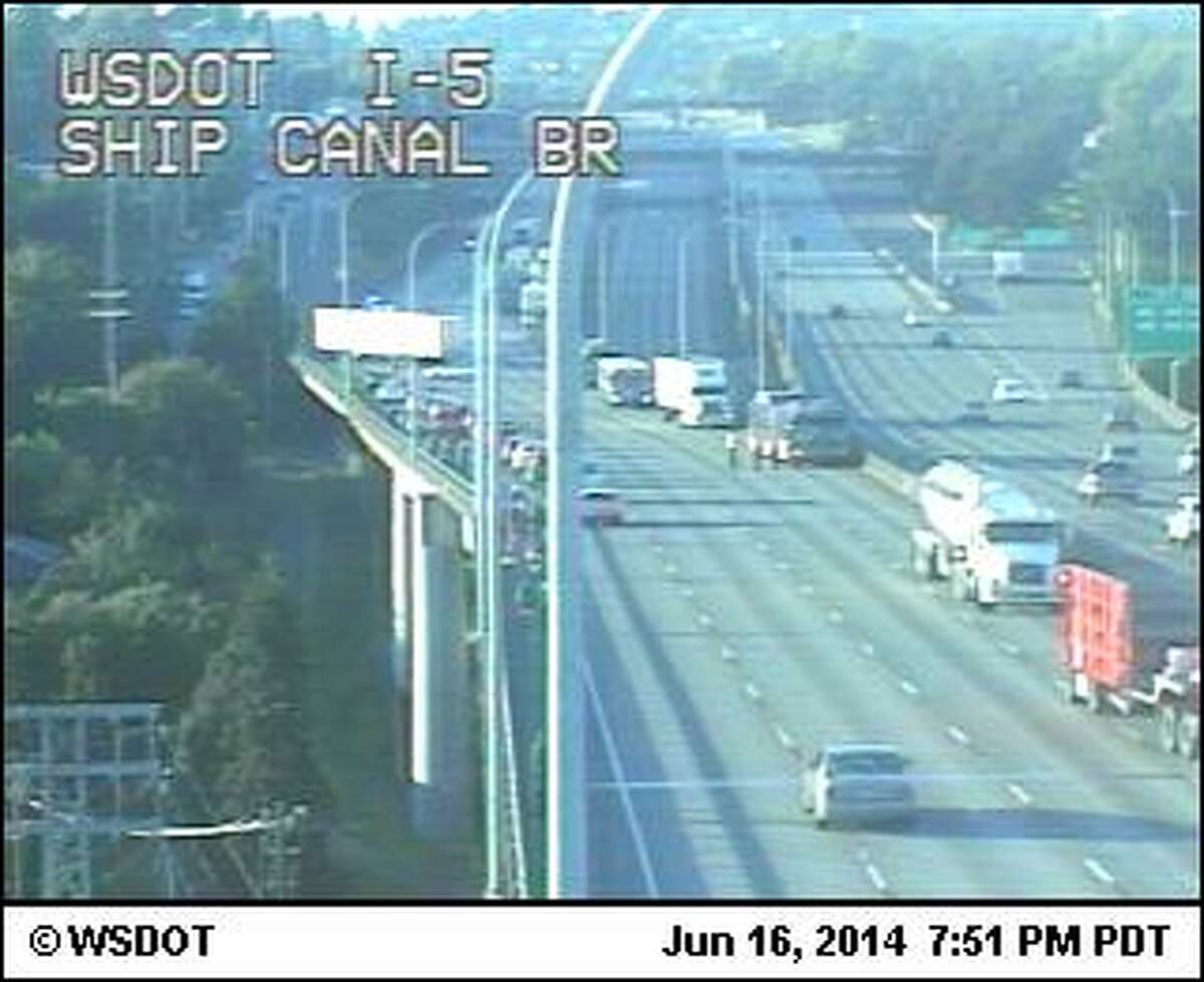An apparent police shooting has closed southbound Interstate 5 at the Ship Canal Bridge in Seattle. The bridge is pictured above in a state Department of Transportation photo.