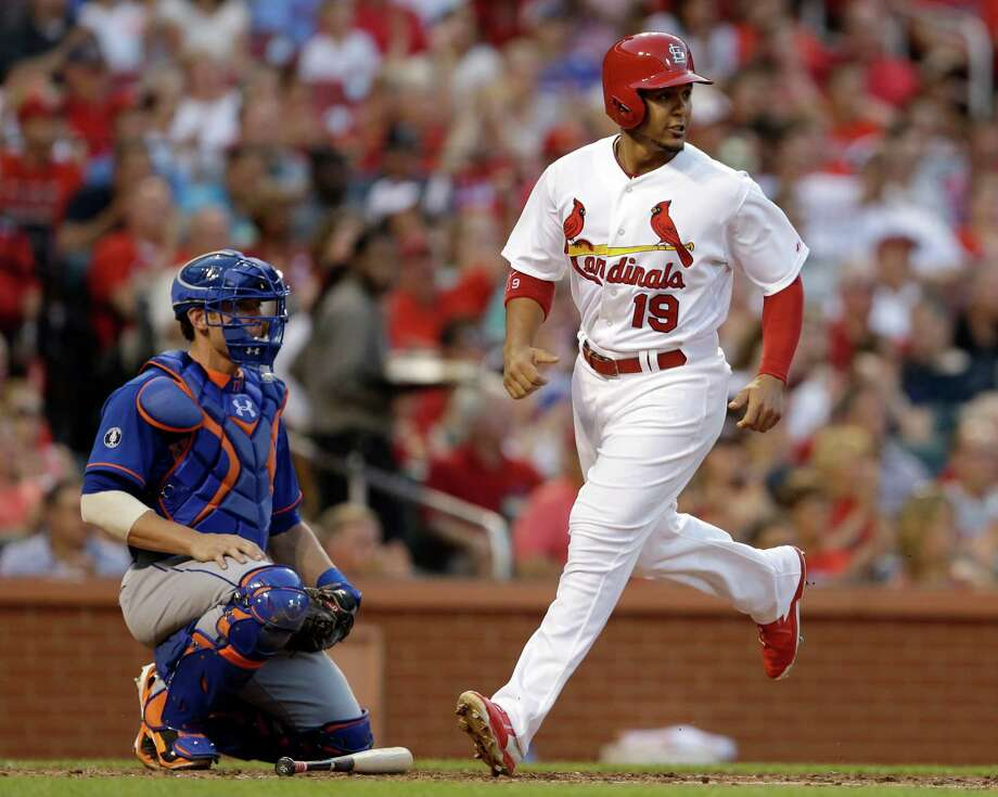 St. Louis Cardinals' Jon Jay, right, scores on a single by Matt Adams as New York Mets catcher Taylor Teagarden watches during the third inning of a baseball game Monday, June 16, 2014, in St. Louis. (AP Photo/Jeff Roberson) ORG XMIT: MOJR109 Photo: Jeff Roberson / AP