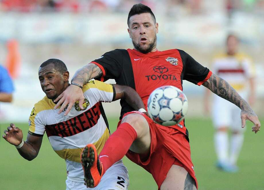 San Antonio Scorpions' Eric Hassli, right, tangles with Ft. Lauderdale Strikers' Darnell King during the first half of an NASL soccer game, Saturday, June 7, 2014, in San Antonio. (Darren Abate/NASL) Photo: Photo By Darren Abate/M3D14.com / Darren Abate/DA Media, LLC