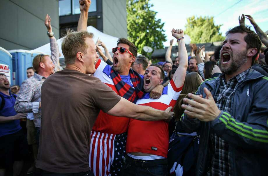 Fans react after USA's John Brooks scored a goal late in the USA-Ghana World Cup match to give the U.S. its final 2-1 lead Monday at the George & Dragon pub in Fremont. Photographed on Monday, June 16, 2014. Photo: JOSHUA TRUJILLO, SEATTLEPI.COM / SEATTLEPI.COM