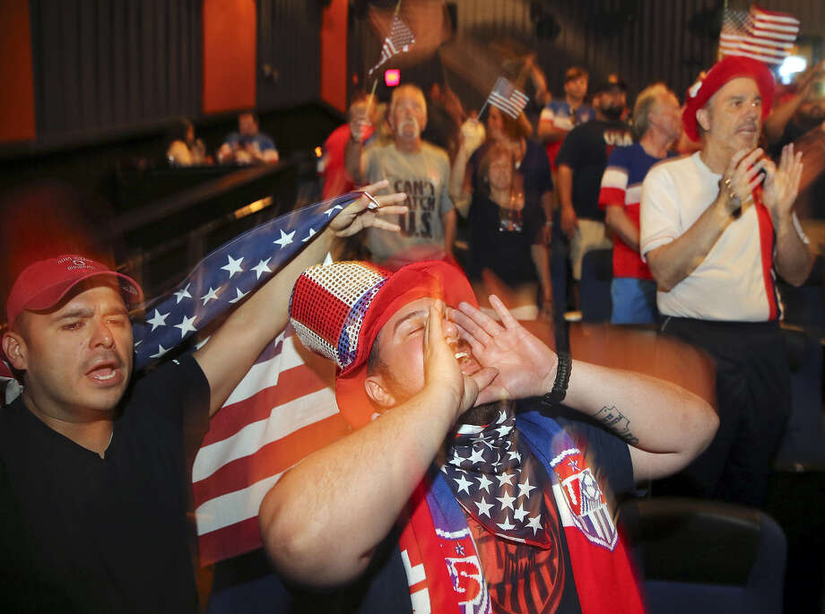 Soccer fans Richard Garcia (left), Justin Herrera, and others cheer during a Crocketteers watch party for the 2014 World Cup match between the USA and Ghana Monday June 16, 2014 at the Santikos Palladium IMAX theatre. Photo: Edward A. Ornelas, San Antonio Express-News / © 2014 San Antonio Express-News