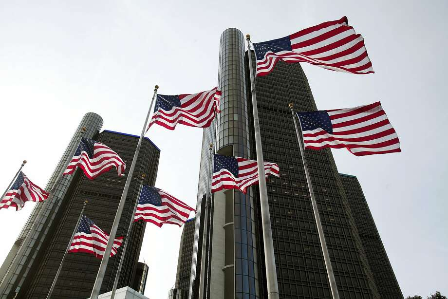 FILE - JUNE 16, 2014: It was reported that  GM is recalling 3.3 million more cars for ignition-switch issue June 16, 2014. DETROIT, MI - JUNE 10:  American flags wave outside the General Motors world headquarters building as the annual shareholders meeting takes place June 10, 2014 in Detroit, Michigan. The meeting comes as 85 federal lawsuits against GM alleging economic losses from ignition-switch defects will be consolidated. (Photo by Bill Pugliano/Getty Images) Photo: Bill Pugliano, Getty Images