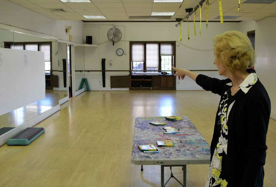 Tammy Pincavage, a Board of Trustees member of the Westport Weston Family Y, points out where she used to wait to pick up her daughters from dance classes almost 30 years ago at the downtown Y, which will be closed later this year. Photo: Jarret Liotta / Westport News