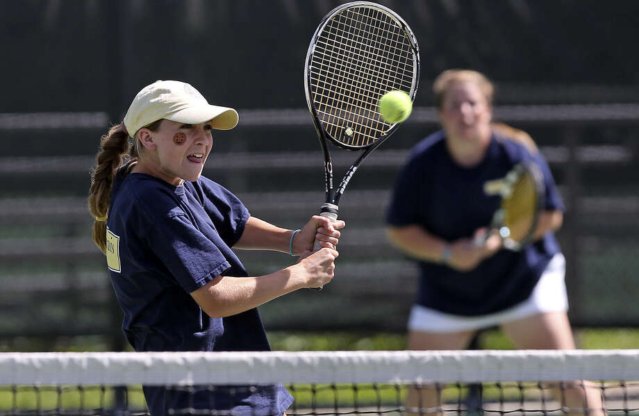 Alamo Heights doubles players Solene Crawley, left, defends the net as she and Marie Lutz compete in the 5A state tennis championship matches on April 29. Photo: Tom Reel / San Antonio Express-News