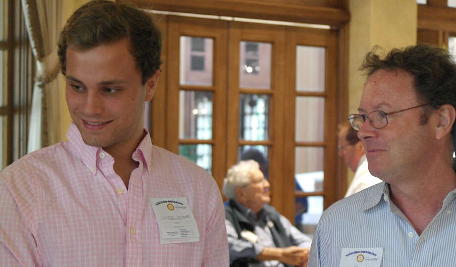 French exchange student Victor Maupus, left, with his San Antonio host, John Purcell, was sponsored by the Dominion Rotary. He publicly thanked the group recently for its support. Photo: Joni Simon / For Alamo Heights Weekly
