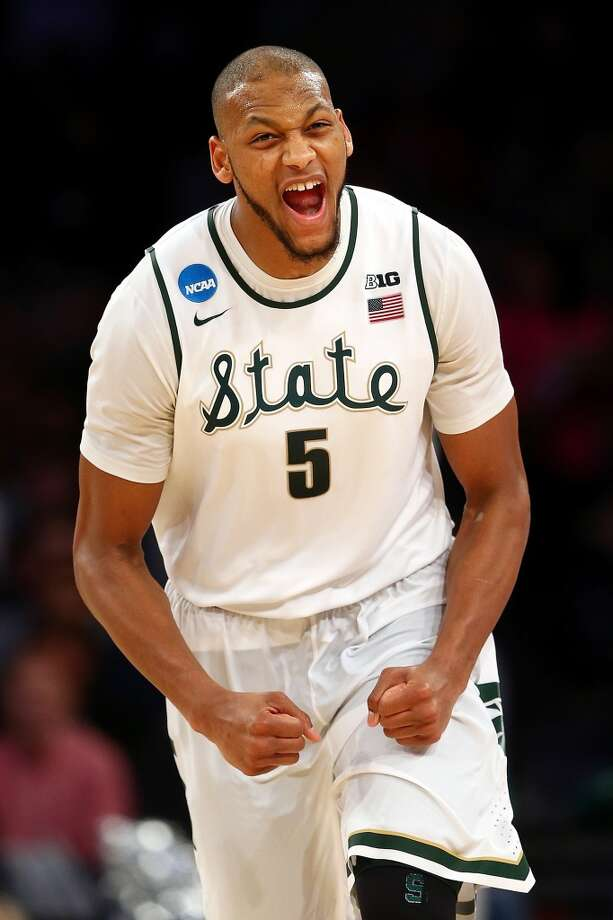 13. Minnesota – Adreian Payne, 6-10, F, Michigan State  Payne elicits a variety of opinions, but if the range-shooting potential he showed in collect holds up at the NBA distance, he could be a solid choice for the Timberwolves and a potential successor for Kevin Love. Photo: Elsa, Getty Images