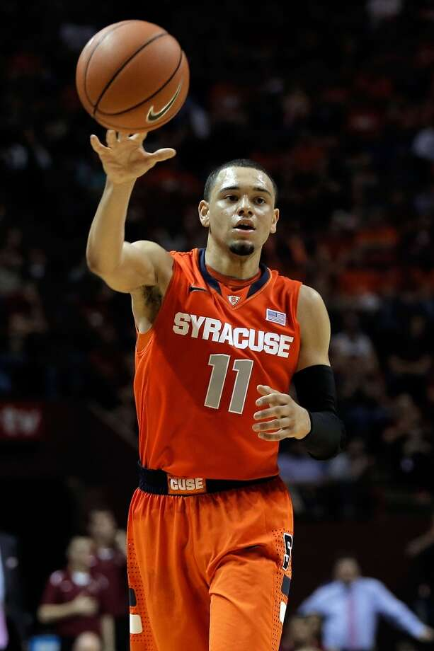 16. Chicago – Tyler Ennis, 6-2, G, Syracuse  Though Ennis fits the Bulls' style more than he does that roster, likely to be a reliable, low-maintenance point guard, he could eventually fit a need, too, with Derrick Rose coming back from his injury and D.J. Augustin a free agent. Photo: Stacy Revere, Getty Images