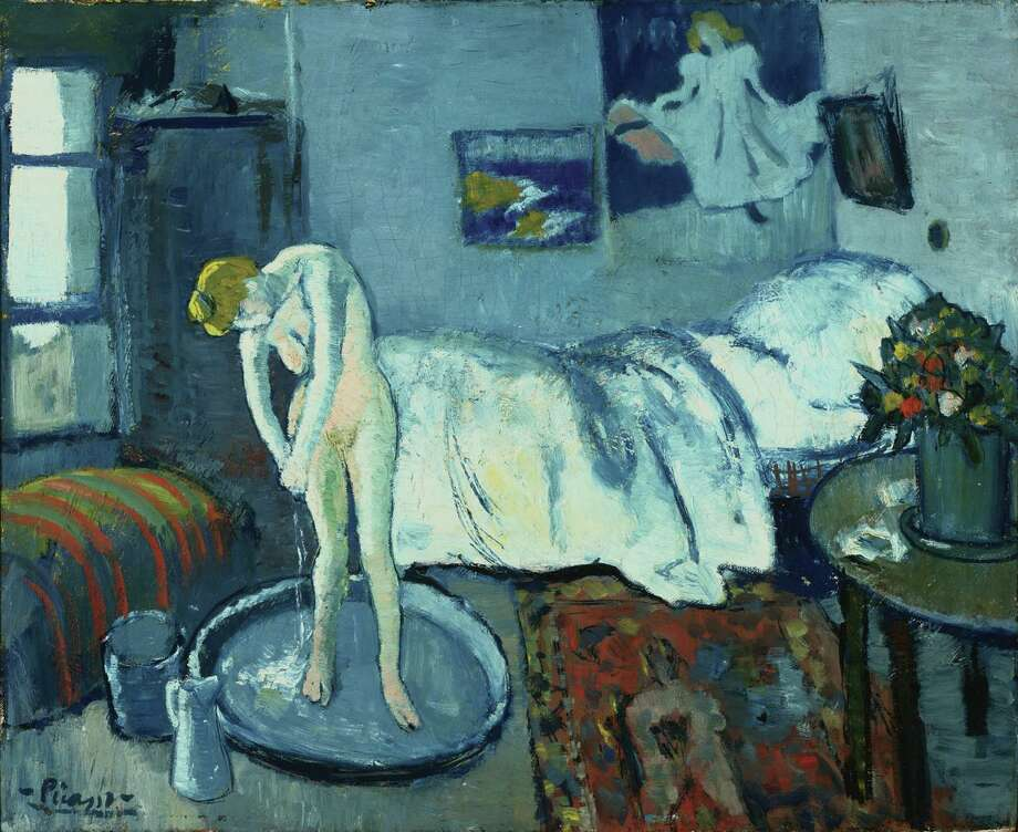This undated handout image provided by The Phillips Collection shows Picasso's The Blue Room, painted in 1901. Scientists and art experts have found a hidden painting beneath the painting. Advances in infrared imagery reveal a bow-tied man with his face resting on his hand, with three rings on his fingers. Now the question that conservators at The Phillips Collection in Washington hope to answer is simply: Who is he? It's a mystery that's fueling new research about the 1901 painting created early in Picasso's career while he was working in Paris at the start of his distinctive blue period of melancholy subjects.(AP Photo/The Phillips Collection) ORG XMIT: WX108 / The Phillips Collection