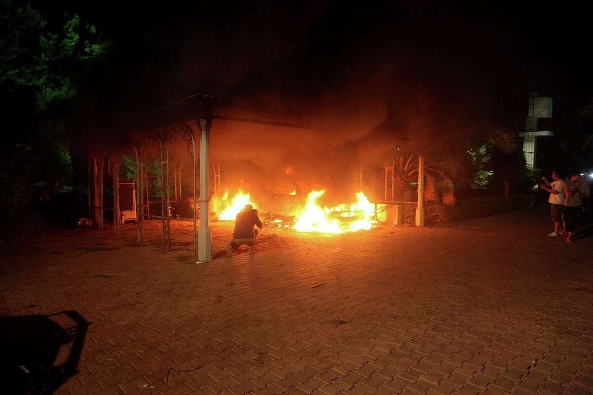 A vehicle and the surrounding area are engulfed in flames after it was set on fire inside the US consulate compound in Benghazi late on Tuesday. An armed mob protesting over a film they said offended Islam, attacked the US consulate in Benghazi and killed the US ambassador and three other Americans. ( STR/AFP/GettyImages)