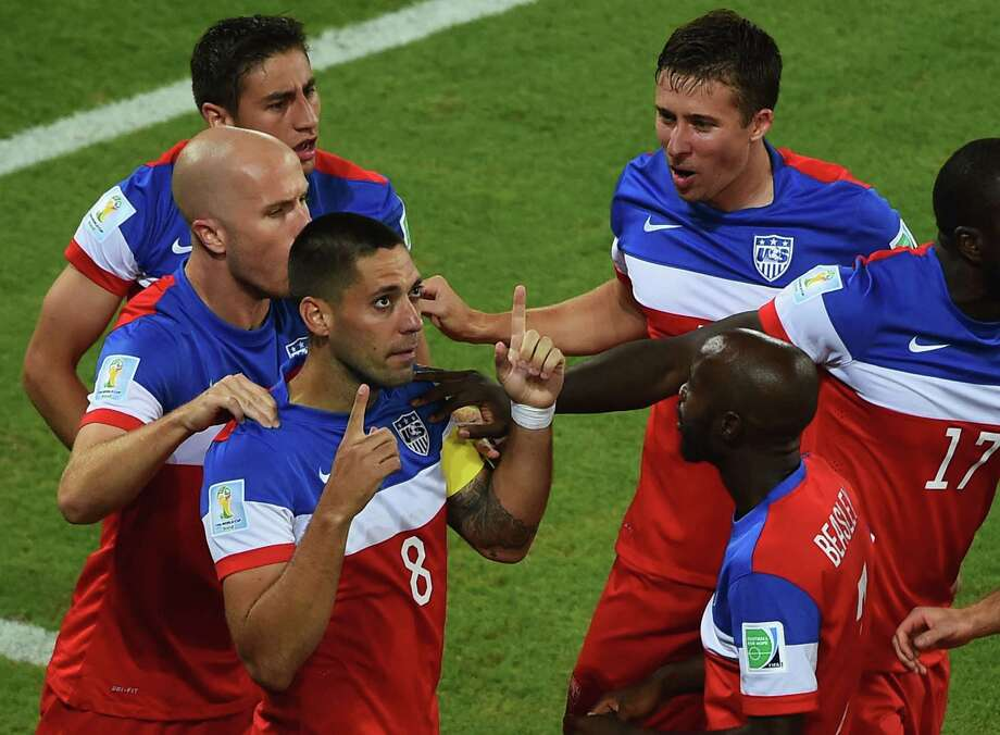 Clint Dempsey of the United States celebrates with teammates after scoring his team's first goal during the 2014 FIFA World Cup Brazil Group G match between Ghana and the United States at Estadio das Dunas on June 16, 2014 in Natal, Brazil. Photo: Laurence Griffiths, Getty Images / 2014 Getty Images