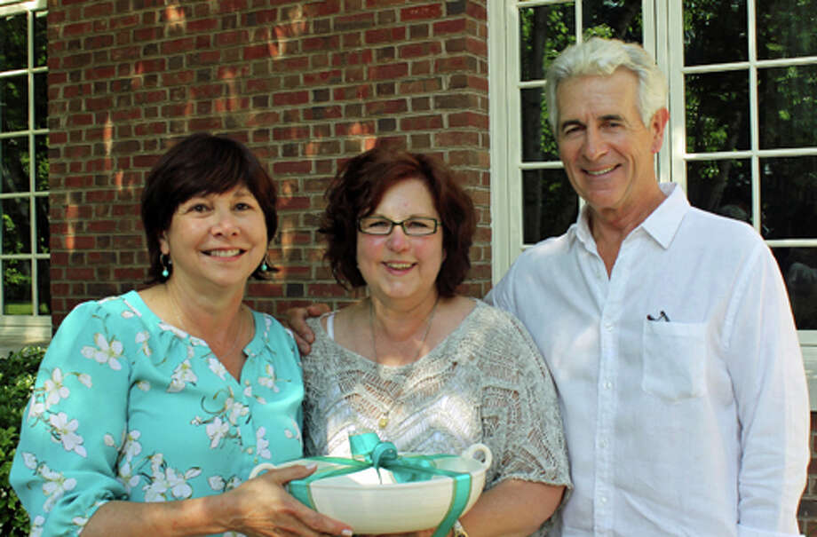 Cultural Alliance of Fairfield County Board President Liz Morten, left, and actor James Naughton honor out-going Executive Director Ryan Odinak, center, for her work building the organization. Photo: Contributed Photo, Contributed / New Canaan News Contributed