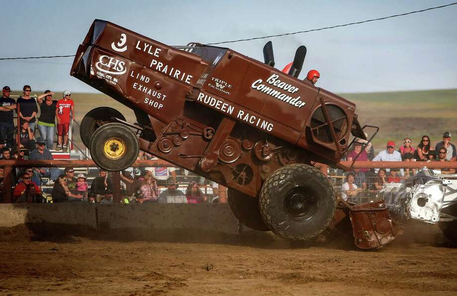 """Driver Eric Labes goes airborne in his multi-ton farming combine """"Beaver Commander"""" during the 27th annual Lind Lions Club Combine Demolition Derby in Adams County. During the event drivers smash the multi-ton machines against competitors until only one machine remains. The teams compete for a $10,000 purse during the annual fundraiser. Lind, in Adams County, is a small community set amid the vast wheat fields of Eastern Washington. Photographed on Saturday, June 14, 2014. Photo: JOSHUA TRUJILLO, SEATTLEPI.COM / SEATTLEPI.COM"""