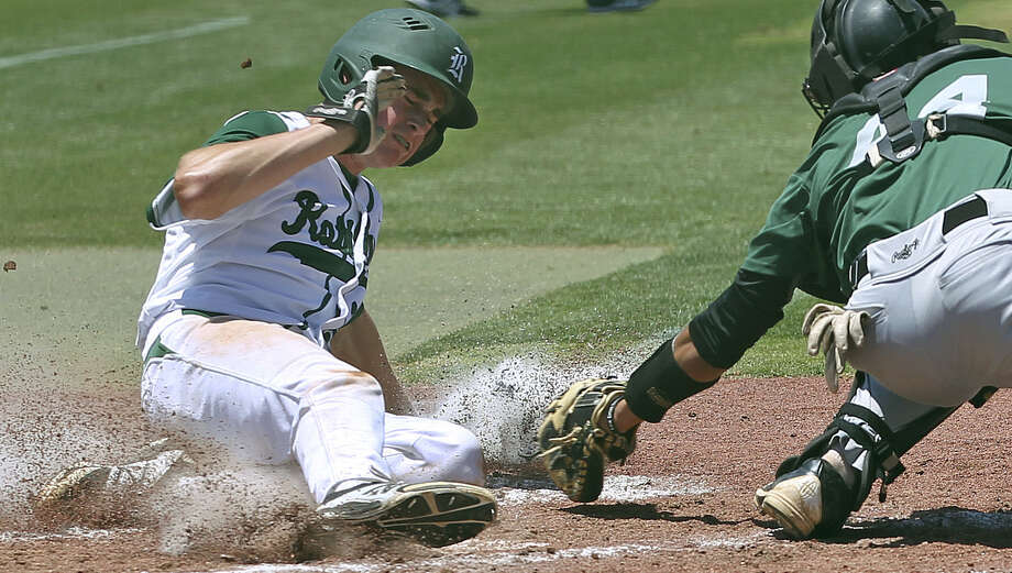 Cade Bormet just gets by the tag of Mustang catcher Erik Lozano as Reagan played Corpus Christi King in 5A regional quarterfinal baseball May 17. Photo: Photos By Tom Reel / San Antonio Express-News / San Antonio Express-News