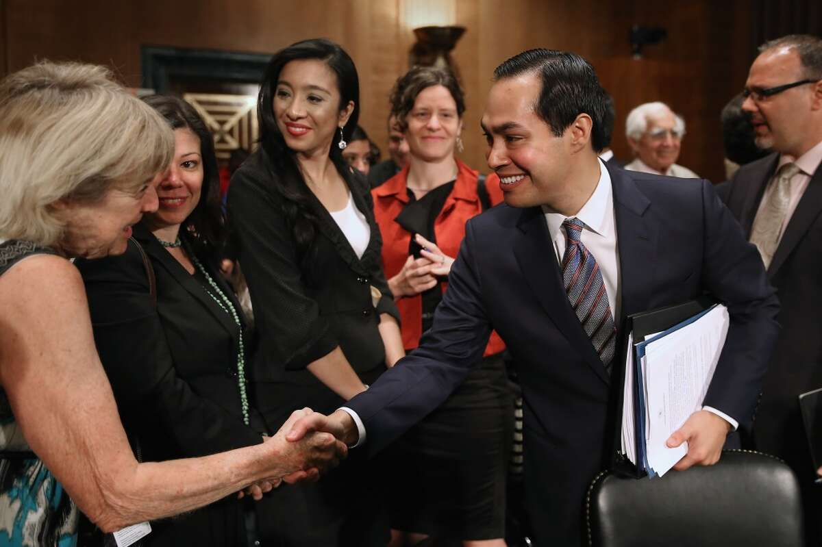 WASHINGTON, DC - JUNE 17: Mayor Julian Castro (2nd R) is congratulated after his confirmation hearing before the Senate Banking, Housing and Urban Affairs Committee with his wife Erica Lira Castro (3rd L) in the Dirksen Senate Office Building on Capitol Hill June 17, 2014 in Washington, DC. The current mayor of San Antonio, Texas, Castro has not faced serious opposition in the Senate. (Photo by Chip Somodevilla/Getty Images)
