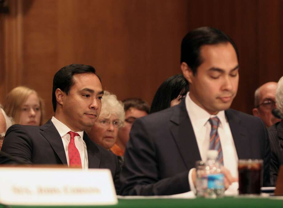 Rep. Joaquin Castro, D-Texas listens at left as his brother, Housing and Urban Development Secretary nominee, San Antonio, Texas Mayor Julian Castro testifies on Capitol Hill in Washington, Tuesday, June 17, 2014, before the   Senate Banking Committee hearing on Julian Castro's nomination.  (AP Photo/Lauren Victoria Burke) Photo: Associated Press