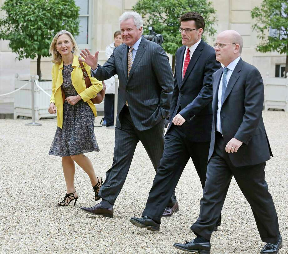 General Electric CEO Jeffrey R. Immelt, second from left, and GE France chairwoman Clara Gaymard, left, arrive at the Elysee Palace for a meeting with French President Francois Hollande in Paris, Wednesday, May 28, 2014. GE rivals Siemens and Mitsubishi Heavy Industries met with Hollande on Tuesday to promote their joint offer to buy parts of French engineering company Alstom and head off a competing bid from GE. At right are: GE Senior Vice President John L. Flannery Responsible for GE's mergers, acquisitions and divestiture activities worldwide, and CEO of GE Power & Water Steve Bolze. (AP Photo/Remy de la Mauviniere) Photo: Remy De La Mauviniere, Associated Press / Associated Press contributed