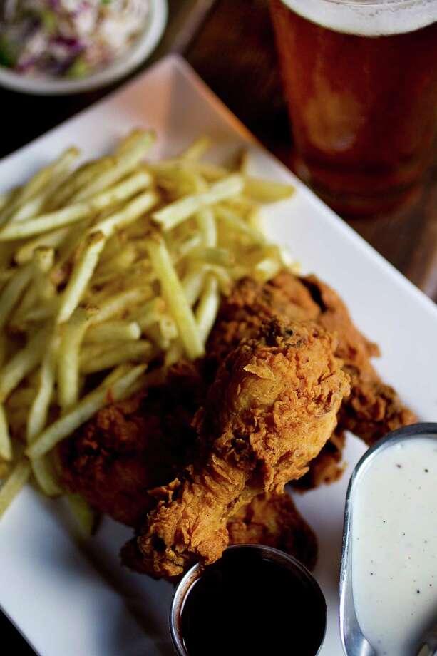 Liberty Kitchen Chef de Cuisine Travis Lenig shows his fried chicken plate, Wednesday, Aug. 22, 2012, in Houston.  ( Nick de la Torre / Houston Chronicle ) Photo: Nick De La Torre, Staff / © 2012  Houston Chronicle