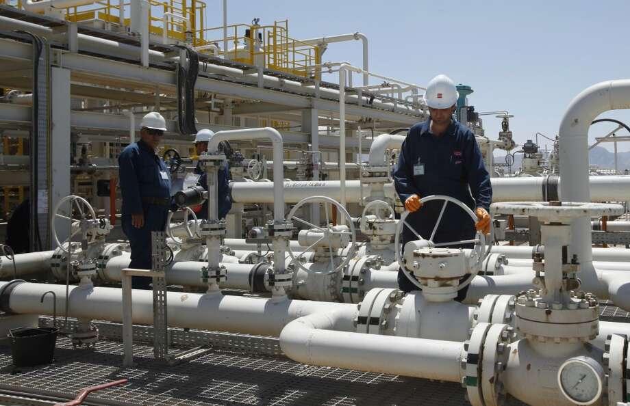 Employees work at the Tawke oil field in the semiautonomous Kurdish region in northern Iraq. Photo: Hadi Mizban, Associated Press