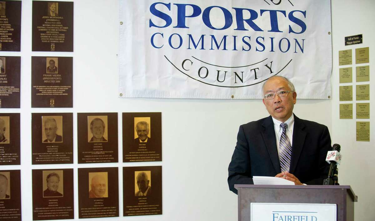 """Wha Chu speaks during a ceremony to announce the new inductees into the Fairfield County Sports Hall of Fame, which include Chu's daughter, Julie Chu, at UCONN Stamford on Tuesday, June 17, 2014. The new inductees are Craig Breslow and Julie Chu into the professional wing, Nadine Domond and Mickey Connolly into the amateur wing, and Efrain """"Chico"""" Chacurian, John """"Sharkey"""" Laureno, and Marty Roos into the community service wing."""