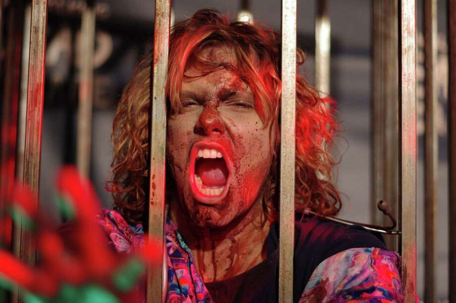 Play the part of a zombie or a survivor when The Walking Dead Escape obstacle course sets down in Hartford, Conn., on June 28, 2014. Volunteers also are needed to keep the action moving. Photo: Contributed Photo / Stamford Advocate Contributed photo