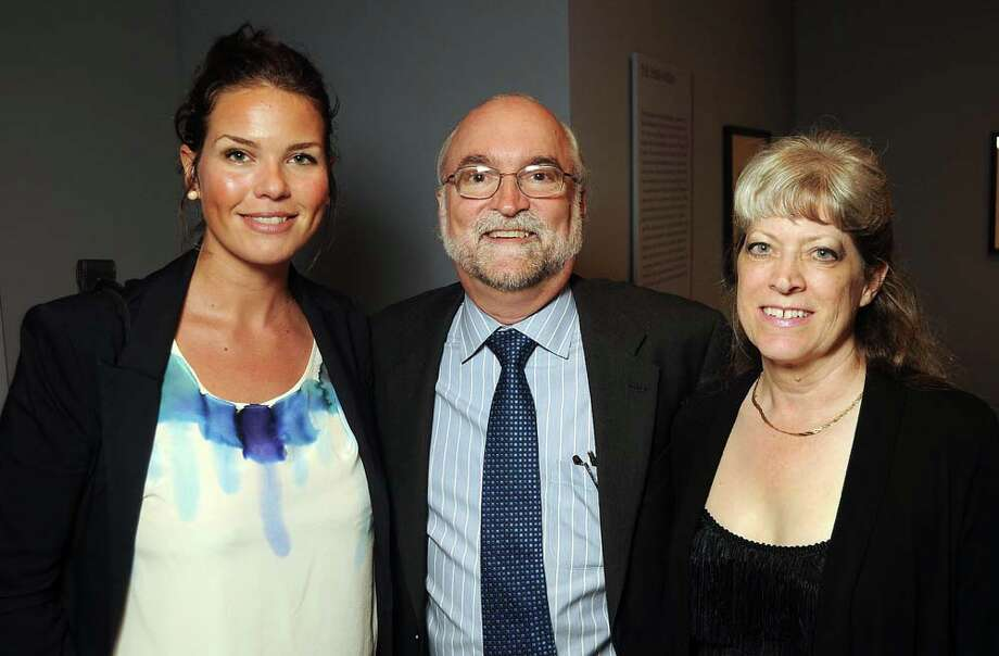 "From left: Jessica Pfifer, Burt Nelson and Karen Belew at the opening of the Charles Marville ""Photographer of Paris"" exhibit at the Museum of Fine Arts Monday June 16, 2014.(Dave Rossman photo) Photo: Dave Rossman, For The Houston Chronicle / © 2014 Dave Rossman"