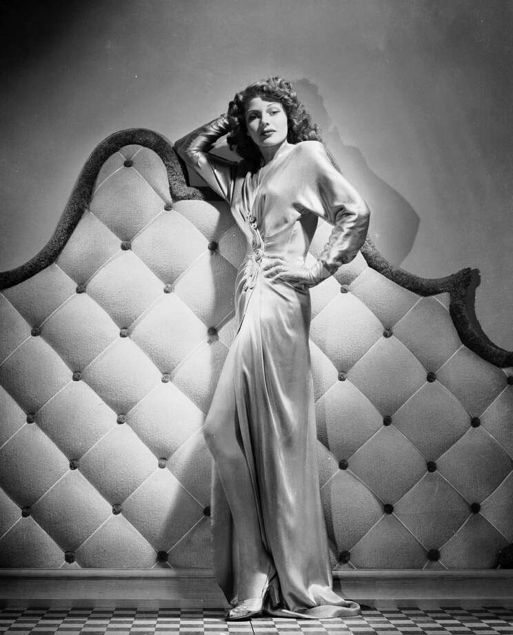 1942American actress Rita Hayworth (1918 -1987) wearing a floor-length gown with a slit up the front. Photo: George Hurrell, Getty / Moviepix